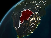 Night over Botswana. Botswana in red on planet Earth at night with visible borderlines and city lights. 3D illustration. Elements of this image furnished by NASA Royalty Free Stock Image