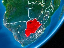 Night over Botswana. Botswana in red on planet Earth at night with visible borderlines and city lights. 3D illustration. Elements of this image furnished by NASA Royalty Free Stock Photos
