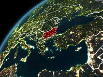 Night over Bulgaria. Bulgaria in red on planet Earth at night with visible borderlines and city lights. 3D illustration. Elements of this image furnished by NASA Stock Images