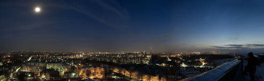 Night over city. Night panoramic shot from rooftop Royalty Free Stock Images