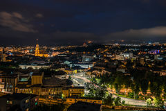 Night over the Cluj-Napoca city. A summer night over the Cluj-Napoca city, Romania. The lights lightening the buildings and the city it seemed in motion Stock Image