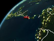 Night over Costa Rica. Costa Rica in red on planet Earth at night with visible borderlines and city lights. 3D illustration. Elements of this image furnished by Royalty Free Stock Images