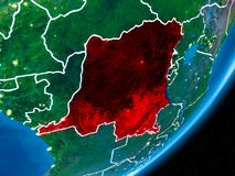 Night over Democratic Republic of Congo. Democratic Republic of Congo in red on planet Earth at night with visible borderlines and city lights. 3D illustration Royalty Free Stock Image