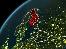 Night over Finland. Finland in red on planet Earth at night with visible borderlines and city lights. 3D illustration. Elements of this image furnished by NASA Stock Images