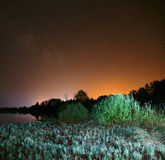 Night over the lake, the stars in the night sky, a falling star Royalty Free Stock Photography