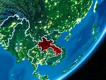 Night over Laos. Laos in red on planet Earth at night with visible borderlines and city lights. 3D illustration. Elements of this image furnished by NASA Stock Photography