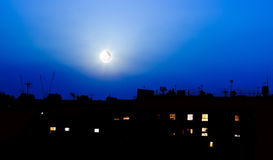 Night over London buildings with moon Stock Images