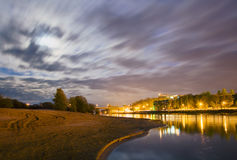 Night over the river, the moon and the clouds in the night sky Stock Image