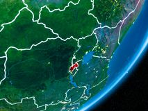 Night over Rwanda. Rwanda in red on planet Earth at night with visible borderlines and city lights. 3D illustration. Elements of this image furnished by NASA Stock Photography
