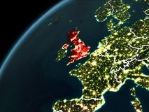 Night over United Kingdom. United Kingdom in red on planet Earth at night with visible borderlines and city lights. 3D illustration. Elements of this image Royalty Free Stock Image