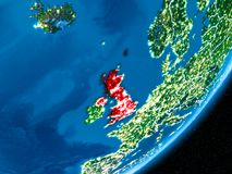 Night over United Kingdom. United Kingdom in red on planet Earth at night with visible borderlines and city lights. 3D illustration. Elements of this image Stock Photo