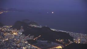 Night panning shot from botafogo, sugarloaf mountain to copacabana beach in rio