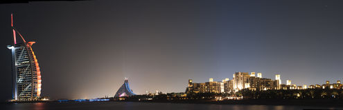 Night Panorama of Dubai Beach. Extreme detailed panorama of Dubai luxury beach. at the far left the luxuros burj dubai, in the middle the Jumeira beach Hotel and Royalty Free Stock Photos