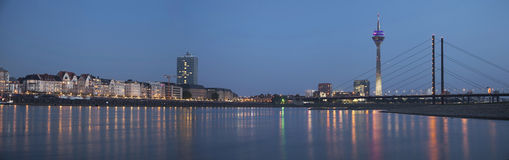 Night panorama of Dusseldorf. With Rheinturm tower and Rheinkniebrucke Bridge Royalty Free Stock Images
