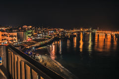 Night panorama of the embankment in the city of Chersonissos, Crete, Greece Royalty Free Stock Photo