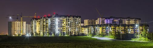 Night panorama of new built and still under construction apartment buildings royalty free stock photos