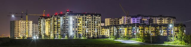 Night panorama of new built and still under construction apartment buildings stock photos