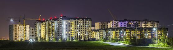 Night panorama of new built and still under construction apartment buildings stock photography