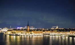Night panorama with northern lights of Gamla Stan, Stockholm , Sweden Royalty Free Stock Photos