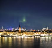 Night panorama with northern lights of Gamla Stan, Stockholm , Sweden Royalty Free Stock Image