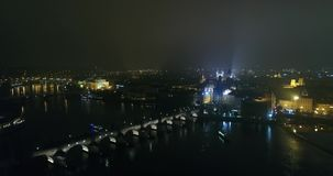 Night panorama of Prague, panoramic view from the air to the old town and Charles Bridge, lights of the night city stock footage