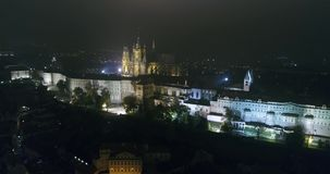 Night panorama of Prague, Panoramic view from the air to St. Vitus Cathedral in Prague, lights of the night city, Prague stock video footage