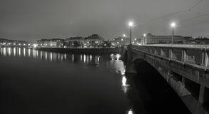 Night panorama  view over river to old stony bridge between historical parts of town Royalty Free Stock Photo