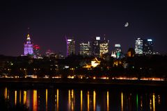 Night skyline of Warsaw with moon stock photos