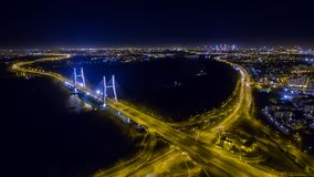Night panorama of Warsaw from drone. Night panorama of Warsaw from above, Siekierkowski bridge and downtown, photo from the drone, November 2016, Warsaw, Poland royalty free stock photos