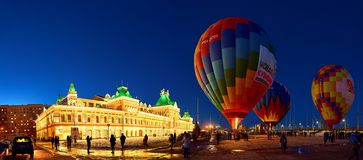 People inflate a huge balloon with a basketpeople rise into the air in the balloon royalty free stock photography