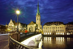 Night panoramic photo of city of Zurich and reflection in Limmat River, Switzerland Stock Images
