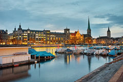 Night panoramic photo of Zurich and reflection in Limmat River, Switzerland Stock Photo