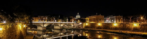 Night panoramic view with Castel St. Angelo Bridge and papal basilica. Night panoramic view with river Tiber in Rome, Vatican City St Peters Basilica and Ponte stock photography