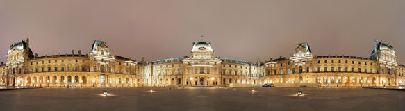 Night panoramic view of the Louvre Museum, Paris Royalty Free Stock Images