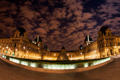 Night panoramic view of the Louvre Museum in Paris, France. Royalty Free Stock Photo