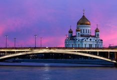 Night panoramic view of Moscow Christ the Savior Cathedral, Bolshoy Kamenny Bridge, Moskva river and embankment in evening lights stock photography