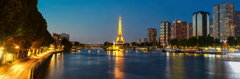 The night panoramic view of Seine river, skyscrapers and Eiffel Tower . Royalty Free Stock Image