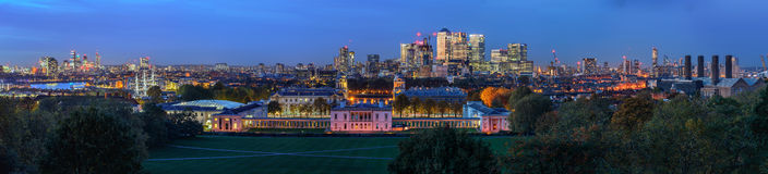 Night panoramic view to Greenwich and Canary Wharf in London Stock Images