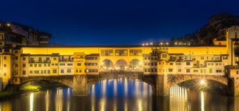 Night panoramic view of Vecchio Bridge, Florence. Night panoramic view of Ponte Vecchio Bridge Florence, Italy Stock Photo