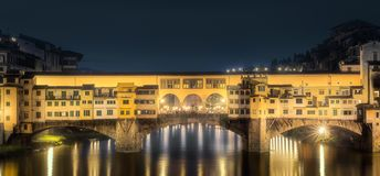 Night panoramic view of Vecchio Bridge, Florence. Night panoramic view of Ponte Vecchio Bridge Florence, Italy. Clipping path of sky stock photo