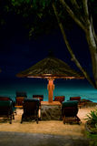 Night paradise beach with deck chair and umbrella Stock Photo