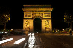 Night Paris, Arc de Triomphe. Arc de Triomphe and Champs-Elysees avenue at night Royalty Free Stock Images