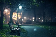 A Night in the Park. Late Autumn Night in the Park. Wood Benches and Park Alley. Horizontal Photography. Central Europe Stock Images