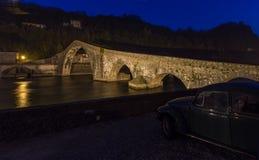 Night parking in Tuscany. Ponte della Maddalena Italian: `Bridge of Mary Magdalene` is a bridge crossing the Serchio river near the town of Borgo a Mozzano in royalty free stock photos