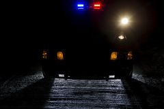 Night patrol. A police car at night with its lights on Royalty Free Stock Image