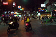 Night patrol on a street in Patong.  Editorial only. Thailand. Night  patrol police on a street in Patong.  Editorial only Stock Photography