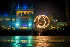 Night performance fire show in front of a crowd of people royalty free stock photo