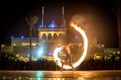 Night performance fire show in front of a crowd of people royalty free stock image