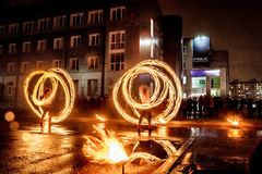 Night performance fire show in front of a crowd of people stock photos