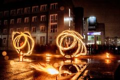 Night performance fire show in front of a crowd of people stock photography